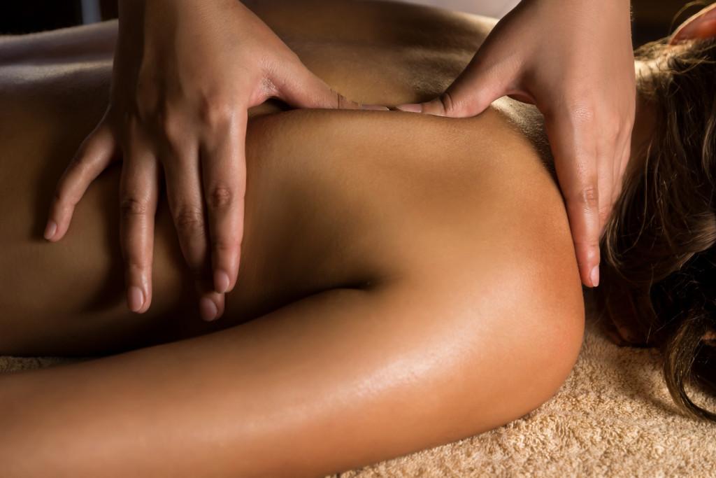 Female shoulder receiving massage